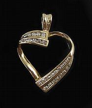 DIAMOND AND FOURTEEN KARAT GOLD PENDANT. The