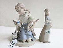 TWO LLADRO FIGURINES of unglazed soft paste