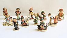 ELEVEN HUMMEL FIGURINES of soft paste porcelain,
