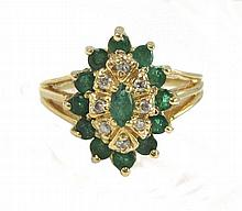 EMERALD, DIAMOND AND FOURTEEN KARAT GOLD RING,