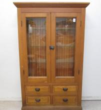 AN OAK DISPLAY CABINET, American, c. 1900, having