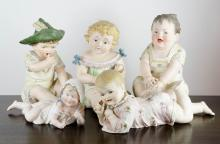 FIVE BISQUE PIANO BABIES, including three seated f