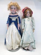 TWO GERMAN BISQUE HEAD DOLLS including an Armand M