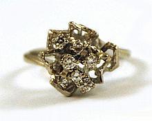 DIAMOND AND FOURTEEN KARAT WHITE GOLD RING, set