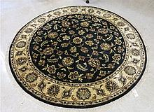 A ROUND ORIENTAL ACCENT RUG, Indo-Persian, hand