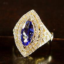 TANZANITE, DIAMOND AND FOURTEEN KARAT GOLD RING, t