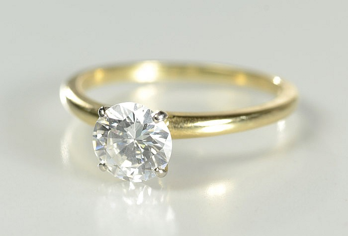 DIAMOND AND FOURTEEN KARAT GOLD SOLITAIRE RING,