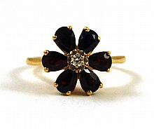 GARNET, DIAMOND AND FOURTEEN KARAT GOLD RING, with