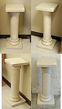 A SET OF FOUR TRAVERTINO OSSO MARBLE PEDESTALS,