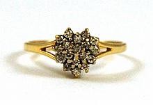 DIAMOND AND YELLOW GOLD CLUSTER RING, featuring a