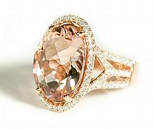 MORGANITE, DIAMOND AND FOURTEEN KARAT GOLD RING.
