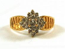 DIAMOND AND FOURTEEN KARAT GOLD RING, with 20
