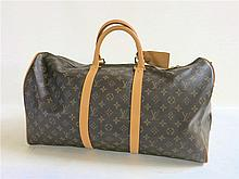 LOUIS VUITTON VALISE/TRAVEL BAG (carry on) having