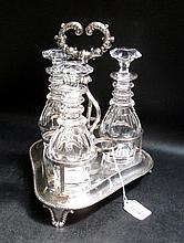 FOUR PIECE SILVER PLATED CASTER SET