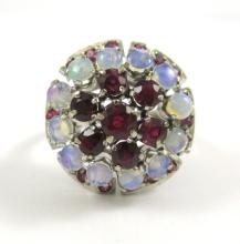 RUBY, OPAL AND EIGHTEEN KARAT WHITE GOLD RING.  Th