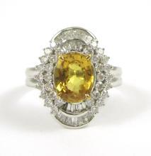 YELLOW SAPPHIRE AND EIGHTEEN KARAT GOLD RING.  The