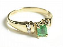 EMERALD, DIAMOND AND FOURTEEN KARAT GOLD RING,