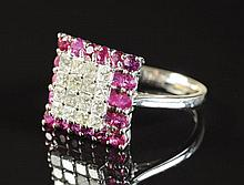 DIAMOND, RUBY AND EIGHTEEN KARAT WHITE GOLD RING,