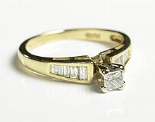 DIAMOND AND FOURTEEN KARAT GOLD RING, with