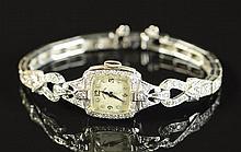 LADY'S DIAMOND AND FOURTEEN KARAT WHITE GOLD