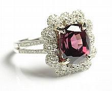 RHODOLITE GARNET AND DIAMOND RING. The 14k white
