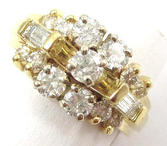 DIAMOND AND FOURTEEN KARAT GOLD RING set with 13
