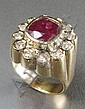 MAN'S RUBY AND FOURTEEN KARAT GOLD RING, centering