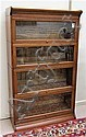 A STACKING OAK BOOKCASE, American, c. 1900, having