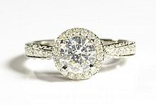 DIAMOND AND FOURTEEN KARAT WHITE GOLD RING,