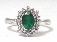 EMERALD, DIAMOND AND FOURTEEN KARAT WHITE GOLD RING