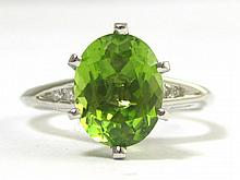 PERIDOT, DIAMOND AND FOURTEEN KARAT WHITE GOLD RING