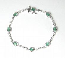 DIAMOND, EMERALD AND 14K WHITE GOLD LINE BRACELET