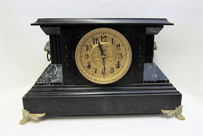 AN AMERICAN INGRAHAM SHELF CLOCK with ebonized and