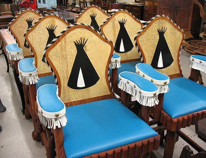 A SET OF SIX WESTERN RANCH STYLE BAR STOOLS,