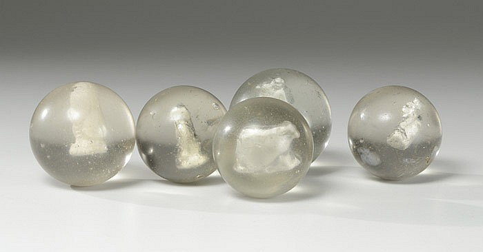FIVE COLLECTIBLE HAND MADE SULPHIDE MARBLES having