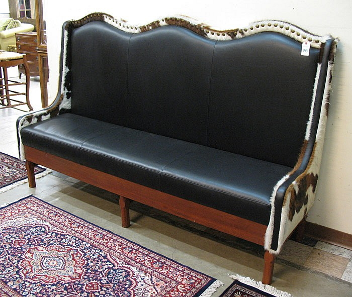 LARGE WINGBACK SETTEE, custom made, with cowhide