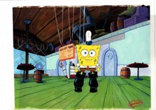 ORIGINAL PRODUCTION CEL OF SPONGEBOB ON PRINT BACKGROUND FROM THE EPISODE SQUEAKY BOOTS