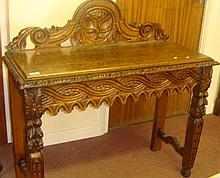 Heavily carved oak sidetable