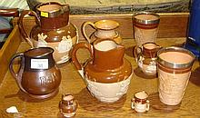 Assorted stone ware jugs, silver rimmed beaker,