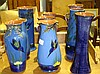 Torquay ware blue ground vases ( 9 pieces)