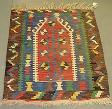 Red ground rug with three central medallions