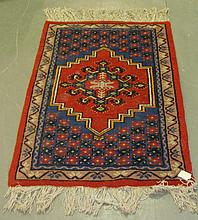 Modern red ground rug with central medallion