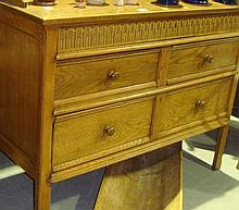 Carved oak chest of drawers with splashback