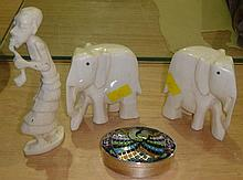 Early 20th century carved ivory elephants and