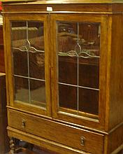 Oak leaded and glazed bookshelf