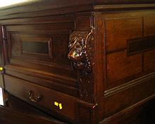 Unusual carved oak cupboard with lion mask
