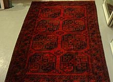 Red ground rug with 8 central lozenges