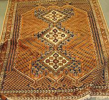 Rug with three central diamond motifs