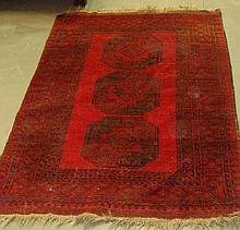 Red ground rug with three diamond panels