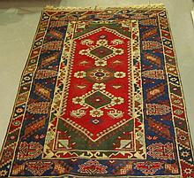 Modern rug with  three diamond patterns in centre